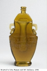 Bottle with lid in fang hu shape
