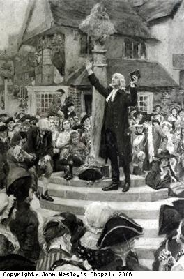 John Wesley preaching from a market cross