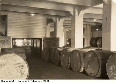 Delivery floor with barrels of tobacco