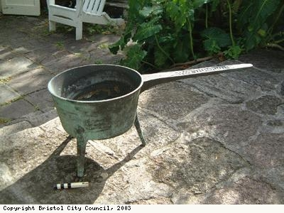 A brass skillet or saucepan